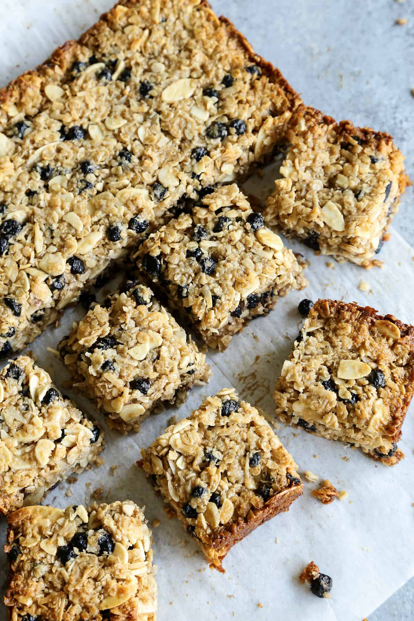 Chewy granola bars with blueberries cut into squares