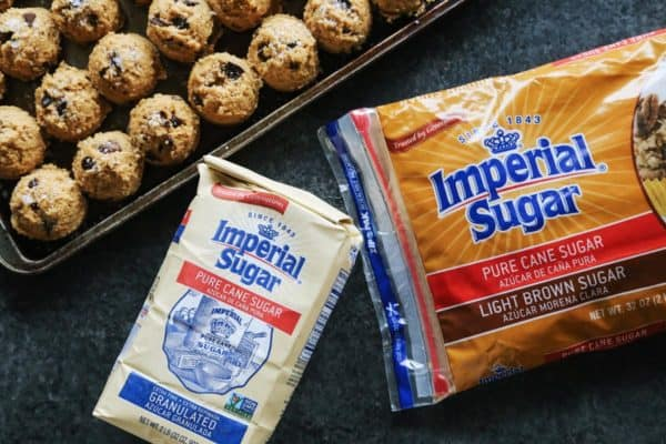a bag of granulated sugar and light brown sugar from Imperial Sugar, plus a pan of cookie dough
