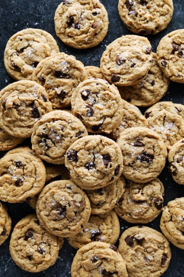 a pile of peanut butter chocolate chip cookies on the counter
