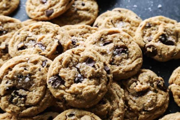 a pile of peanut butter chocolate chip cookies on a counter