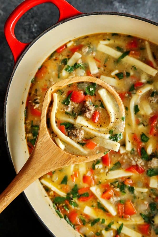 Sausage and Red Pepper Soup with Egg Noodles in a red pot