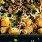 Tater tot nachos with shredded steak, peppers and cheese