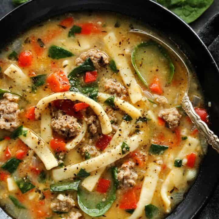 a bowl of Sausage and Red Pepper Soup with Egg Noodles