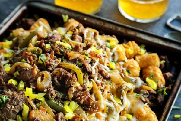 Cheesesteak Totchos on a rimmed baking sheet
