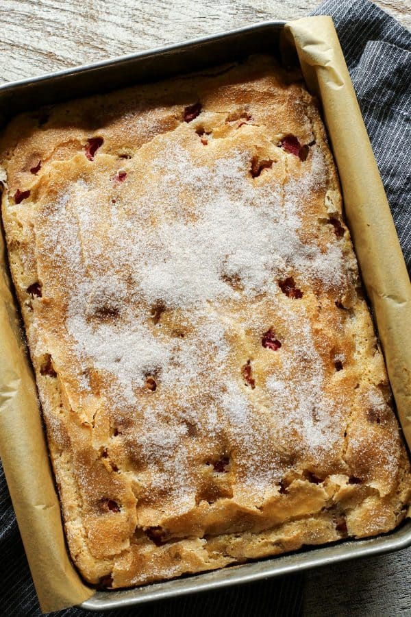 Rhubarb Sour Cream Coffee Cake from afarmgirlsdabbles.com - A tender coffee cake studded with tart bites of rhubarb and topped with a thin and crispy sugar baked crust. #rhubarb #sourcream #coffeecake