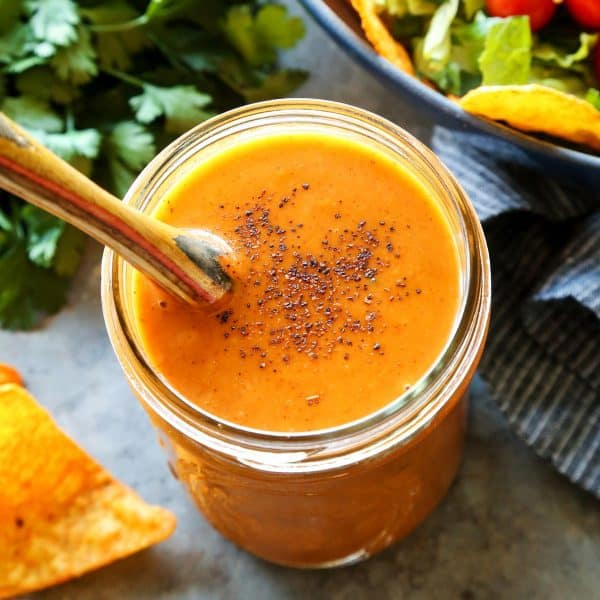Easy, Creamy Taco Salad Dressing from afarmgirlsdabbles.com - Creamy and full of bold flavor, you are not going to believe how easy this is to make. Just three ingredients!