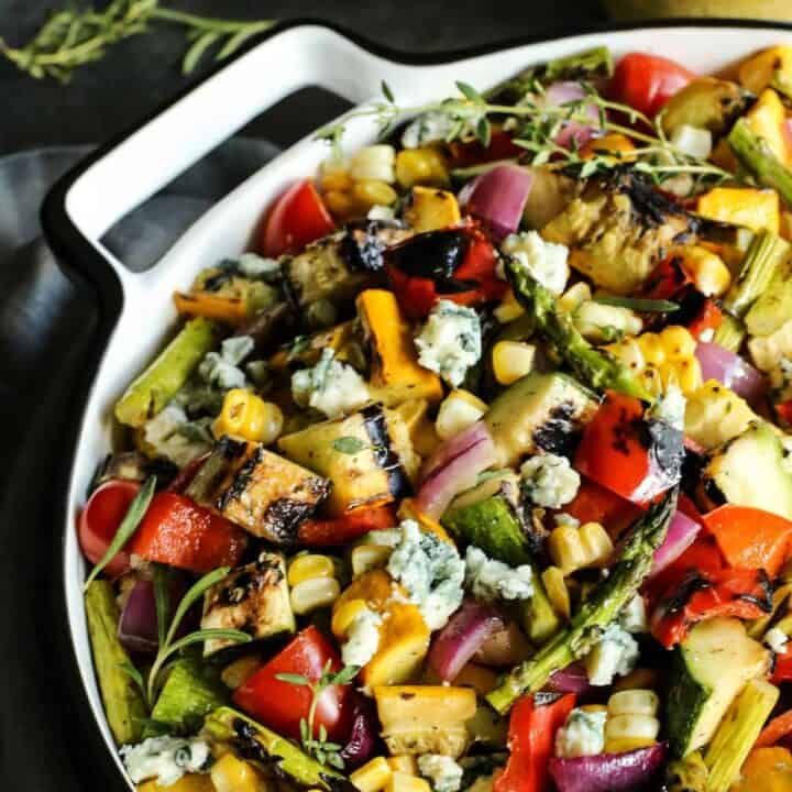 grilled vegetable salad in a large white bowl