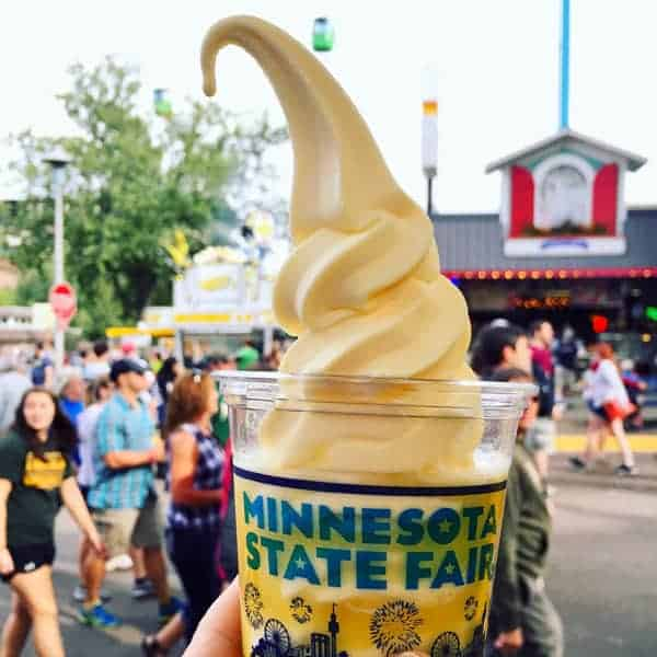 a glass of Dole Whip in a Minnesota State Fair cup