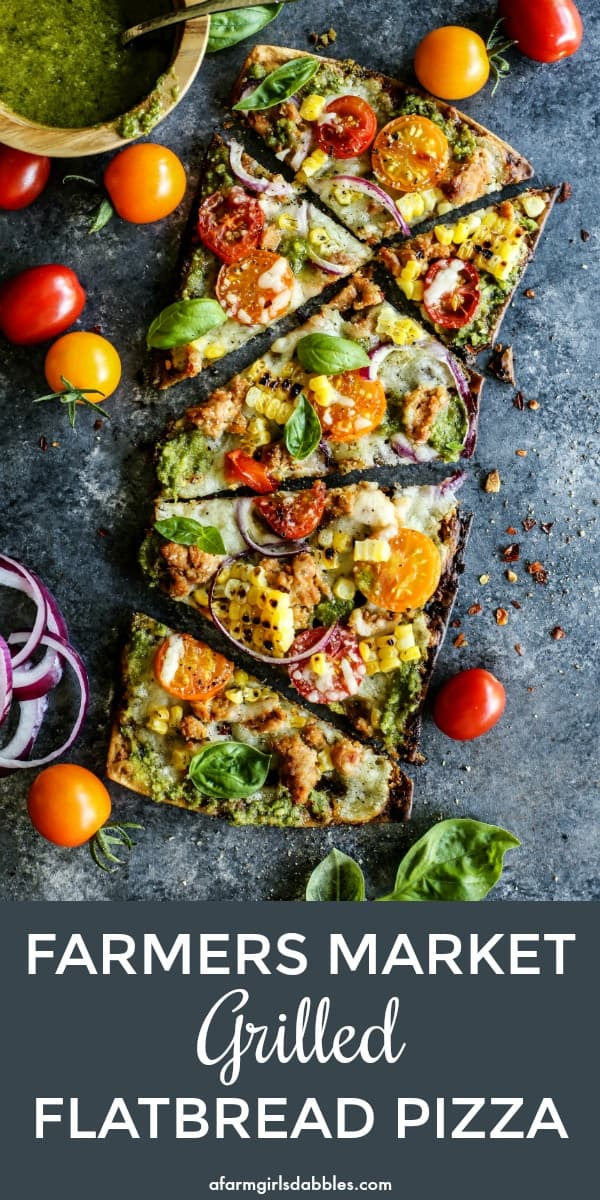 grilled flatbread pizza with pesto, mozzarella cheese, fresh tomatoes, grilled sweet corn, and red onion slices