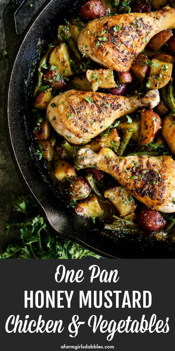 Honey Mustard Chicken and Vegetables (One Pan) from afarmgirlsdabbles.com - A flavorful comfort meal that cooks up in one pan. Rich honey mustard sauce nestles in with the potatoes, greens beans, and crispy-skinned chicken for a complete meal! #honey #mustard #chicken #drumsticks #potatoes #beans