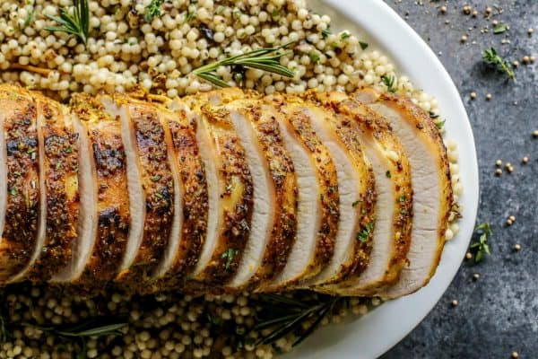 sliced Mustard Pork Loin Roast on couscous