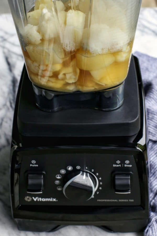 Vitamix blender filled with potato and cauliflower