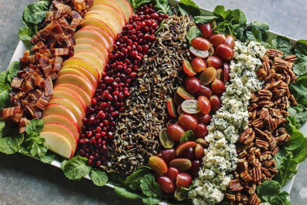 salad with wild rice, pecans, apples, grapes, blue cheese