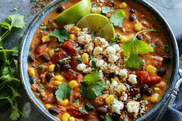 Creamy Enchilada Chili from afarmgirlsdabbles.com - This enchilada chili recipe is brimming with all kinds of tasty bites. In every spoonful, you'll savor the flavors of enchiladas...without the tortillas! #chili #soup #tomato #enchilada