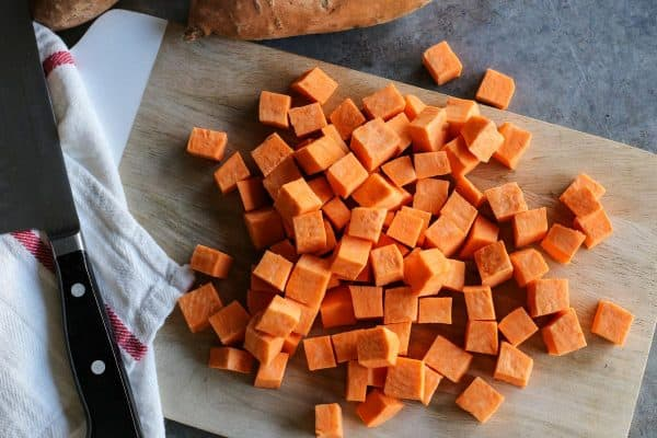 cubed sweet potatoes on cutting board