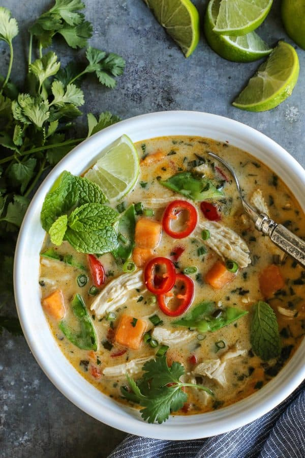 Thai Chicken Soup from afarmgirlsdabbles.com - This lightly creamy, richly flavored Thai soup comes together easily in under an hour. It's hearty with chicken and sweet potatoes, and bursting with all kinds of freshness. Add a little heat, or a lot, it's all up to you! #soup #Thai #chicken #coconutmilk #sweetpotatoes