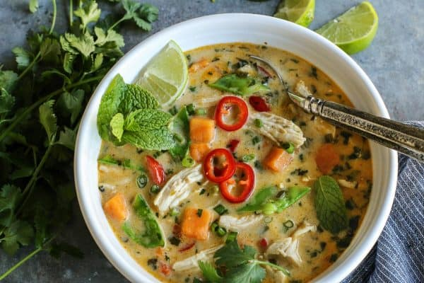 Thai Chicken Soup from afarmgirlsdabbles.com - This lightly creamy, richly flavored Thai soup recipe comes together easily in under an hour. It's hearty with chicken and sweet potatoes, and bursting with all kinds of freshness. Add a little heat, or alot, it's all up to you! #soup #thai #chicken #coconutmilk #coconut #vegetables #sweetpotato #sweetpotatoes