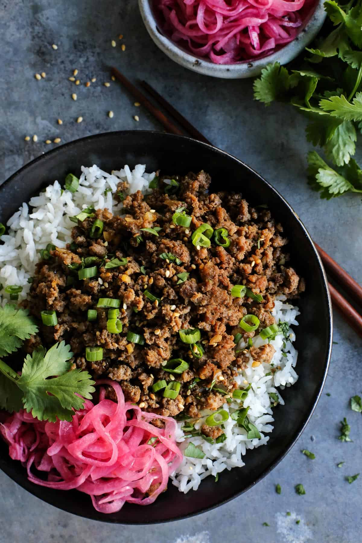 Korean beef over white rice, with pickled red onions