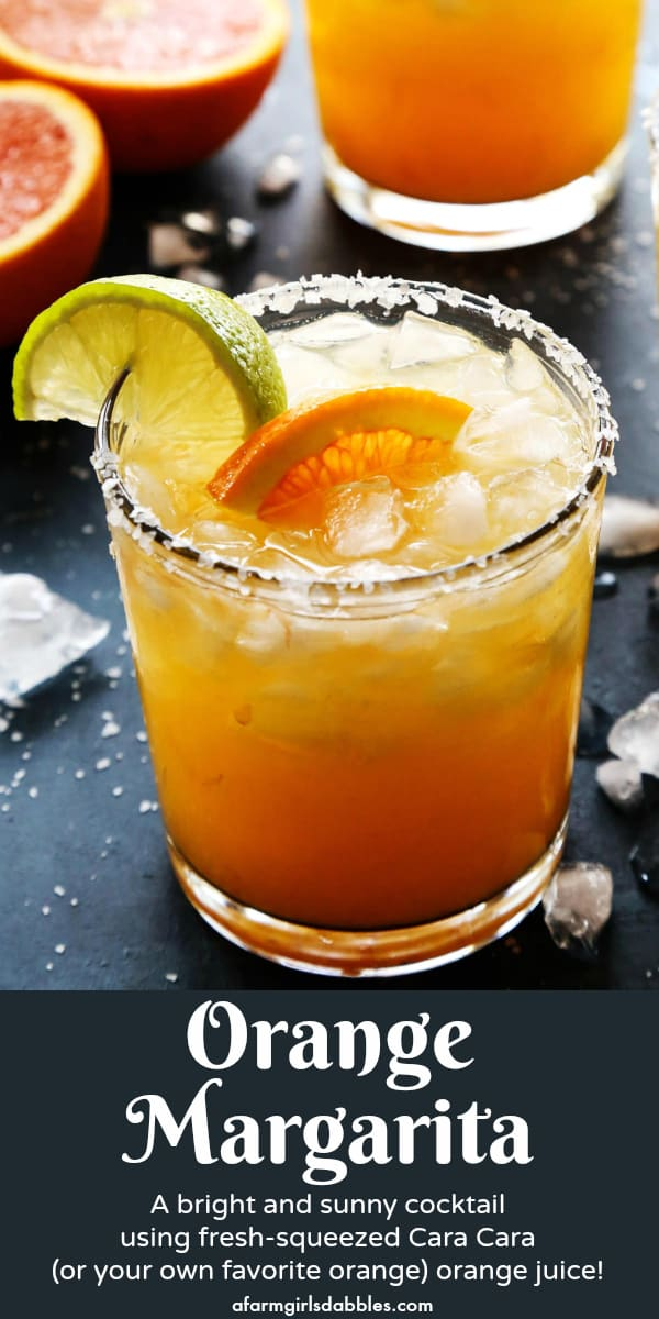 pinterest image of orange margarita in a salt-rimmed glass, with fresh orange halves