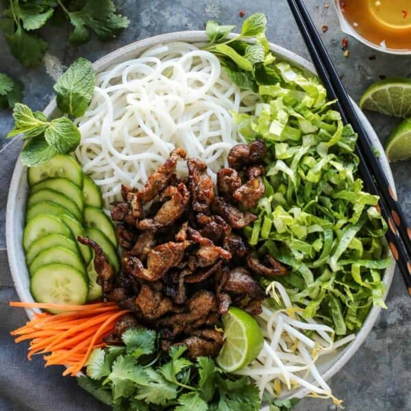 Vietnamese Noodle Salad with Pork from afarmgirlsdabbles.com - A fresh and easy recipe for a traditional Vietnamese salad featuring rice noodles, crunchy vegetables, herbs, and quick-seared pork with big, bold flavor. Served with a rice vinegar dressing to bring it all together.  #vietnamese #ricenoodle #rice #noodle #pork #salad