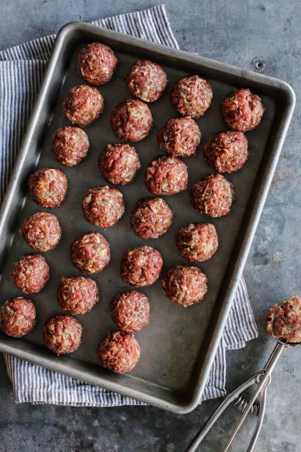 pan of uncooked meatballs