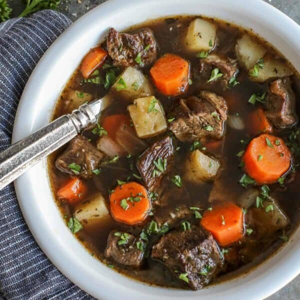 Irish Beef Stew - This Irish stew recipe is rich and hearty, and easy to make. Chunks of beef, potatoes, and carrots simmer until ultra tender in a flavorful beef broth that includes Irish Guinness beer and red wine. #irish #beef #stew #guinness #wine #potatoes #carrots #stpatricksday #comfortfood