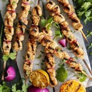 turkey skewers and grilled orange halves