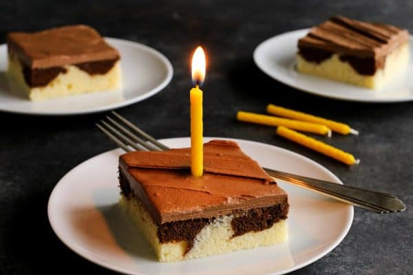piece of marble cake with a yellow candle