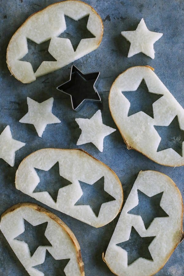 cutting out stars from slices of jicama