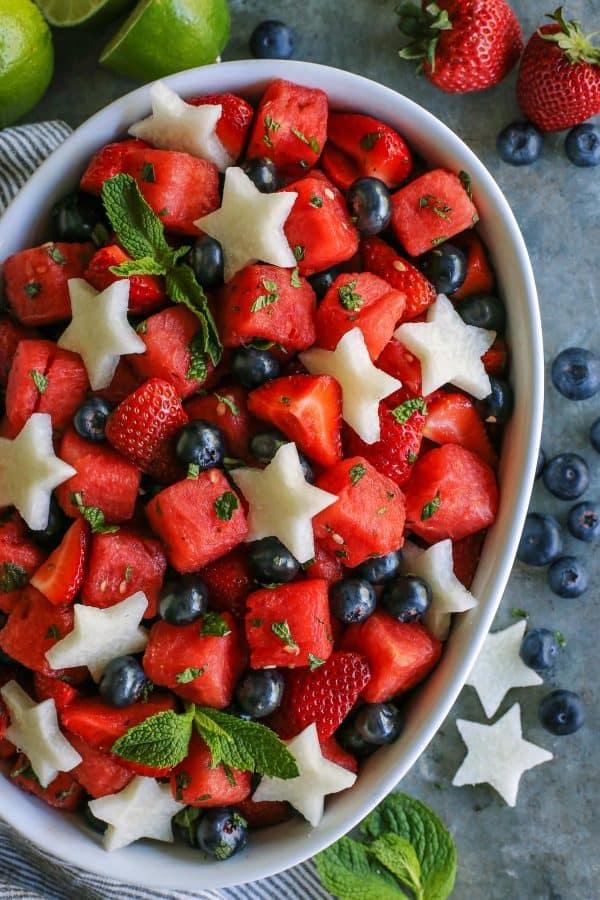 white oblong serving bowl of fresh fruit salad