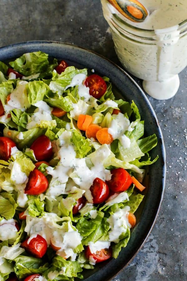 Homemade Buttermilk Ranch Dressing recipe from afarmgirlsdabbles.com - This buttermilk ranch dressing is fresh and creamy and tangy. It's so much better than store-bought, the perfect partner for fresh salads and veggie trays. #buttermilk #ranch #dressing #salad #homemade