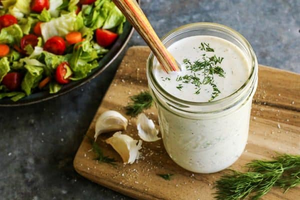 buttermilk ranch with a salad in the background