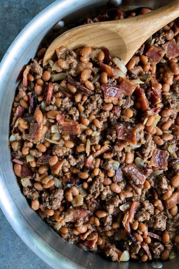 skillet of cowboy beans with bacon and ground beef
