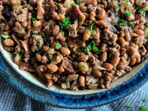 dish of baked beans with bacon and ground beef