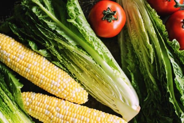 grilled romaine salad has romaine lettuce, tomatoes, and sweet corn