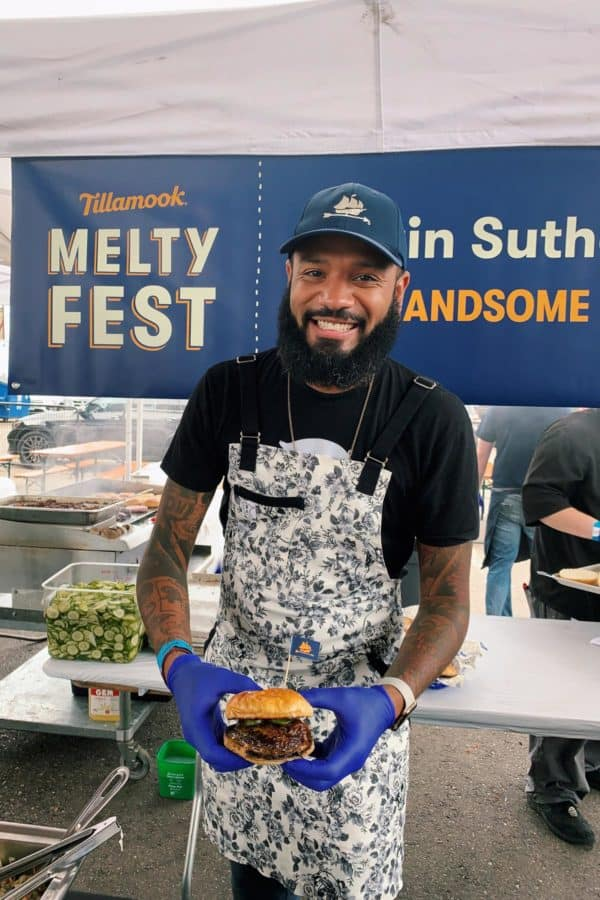 Chef Justin Sutherland holding his version of the Juicy Lucy burger