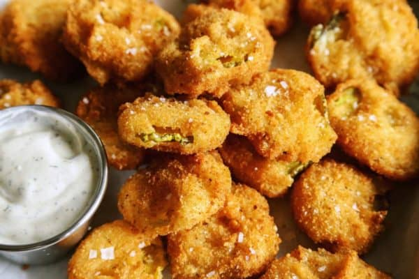 fried pickles on tray with ranch dip