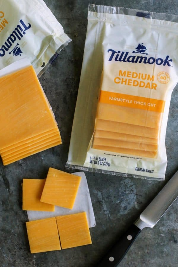 packages of Tillamook farmstyle thick cut medium cheddar slices