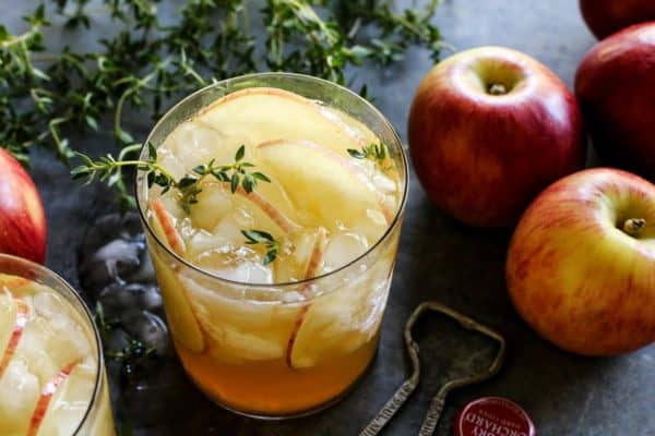 a glass of apple sangria, plus apples