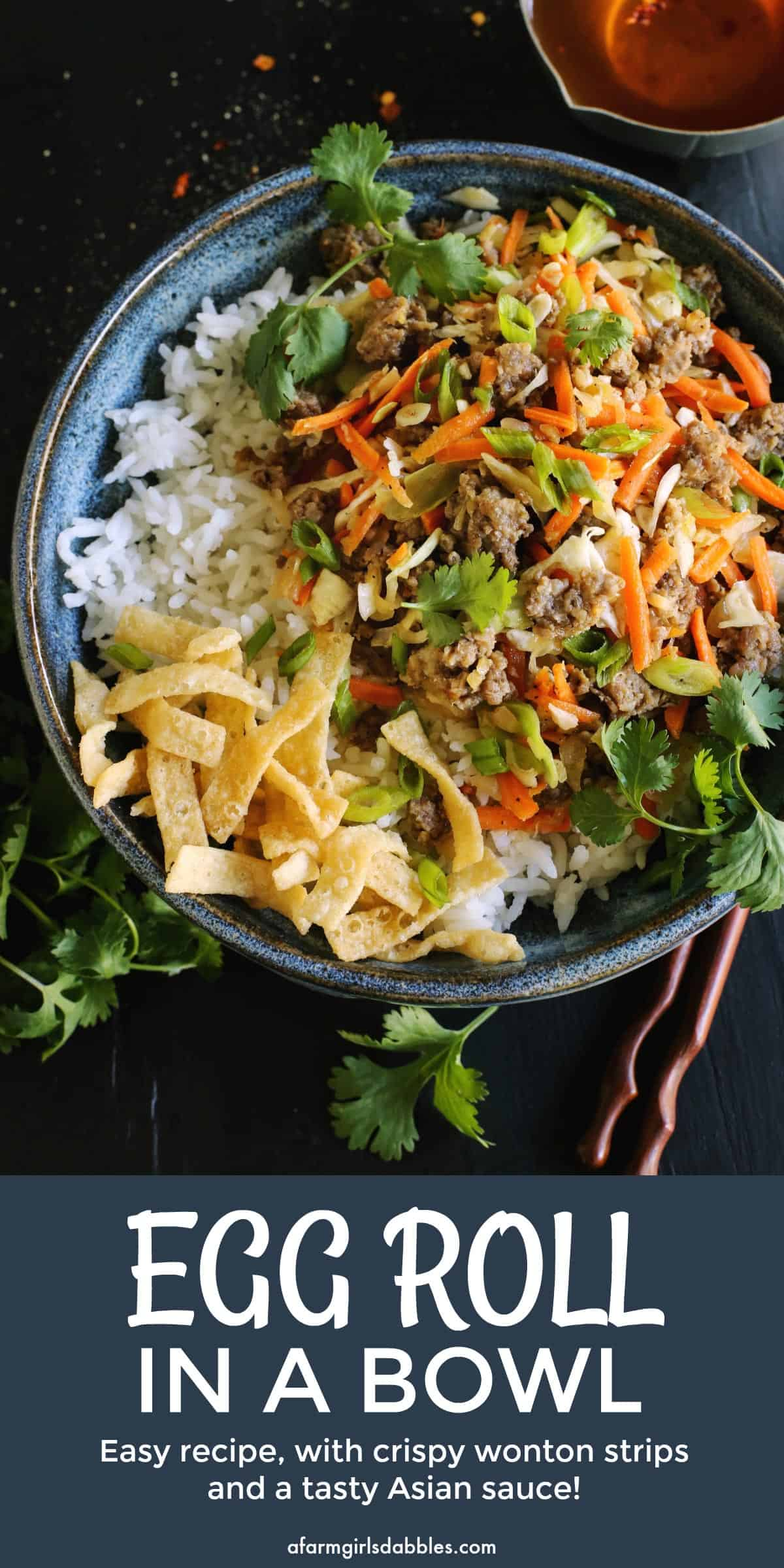 pinterest image of egg roll flavors of ground pork, cabbage, and carrots served in a bowl over white rice