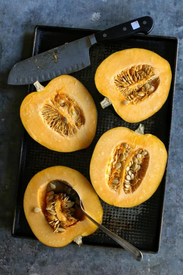 acorn squash cut in half, to reveal inner seeds