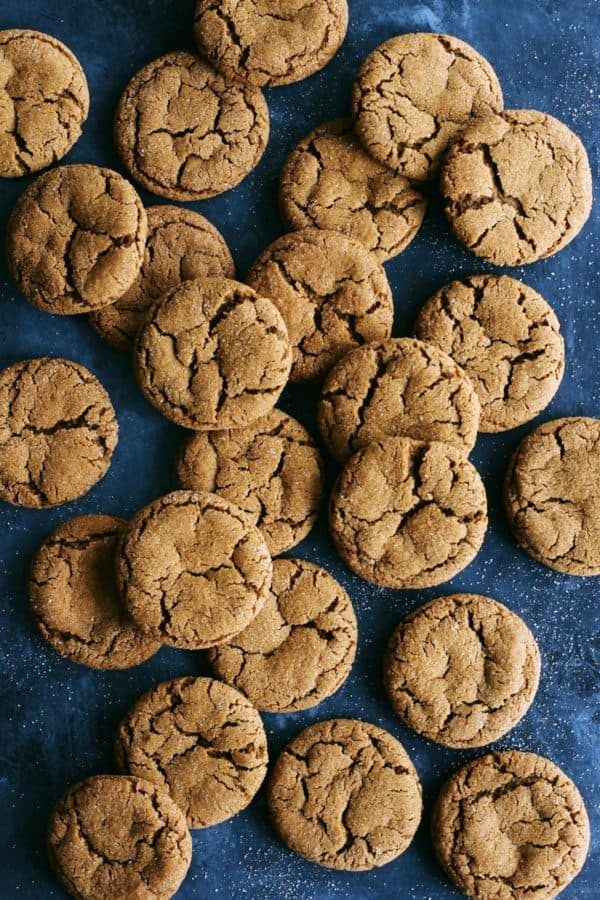ginger molasses cookies on a dark blue background
