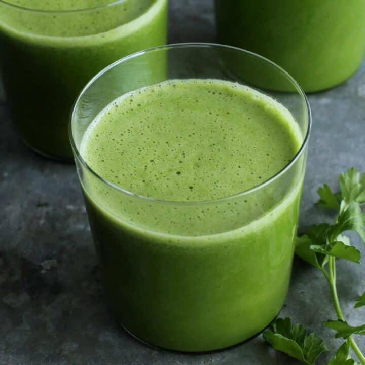 glasses of green juice, plus fresh parsley