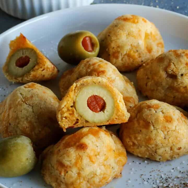 baked olive cheese balls on a plate