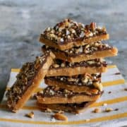 pieces of toffee stacked on a striped plate