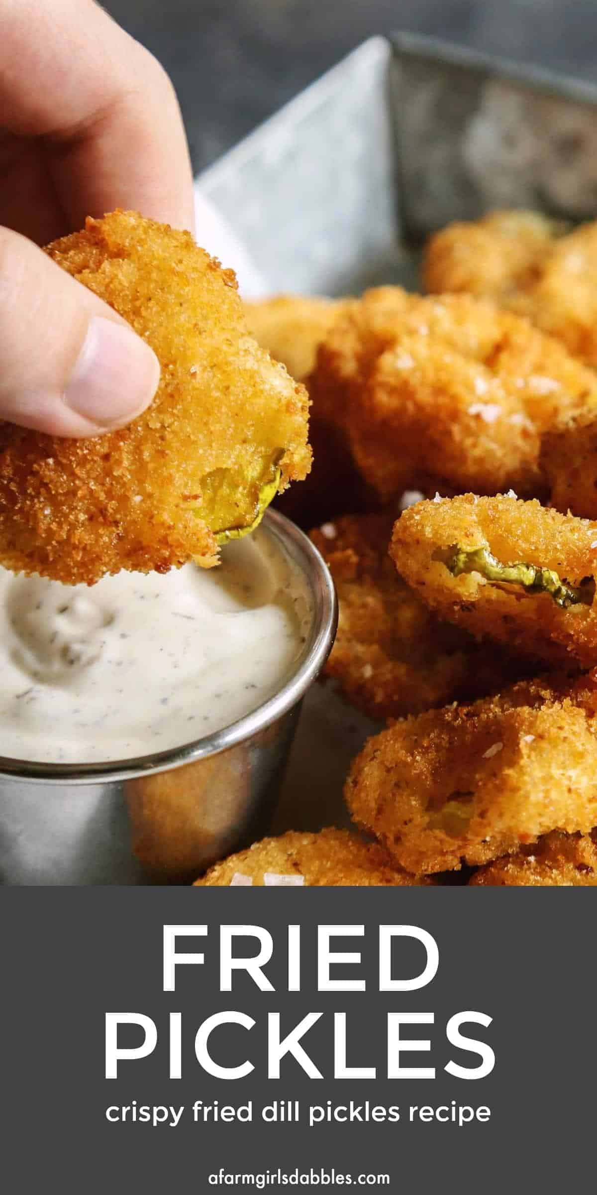 pinterest image of dipping a fried dill pickle into ranch sauce