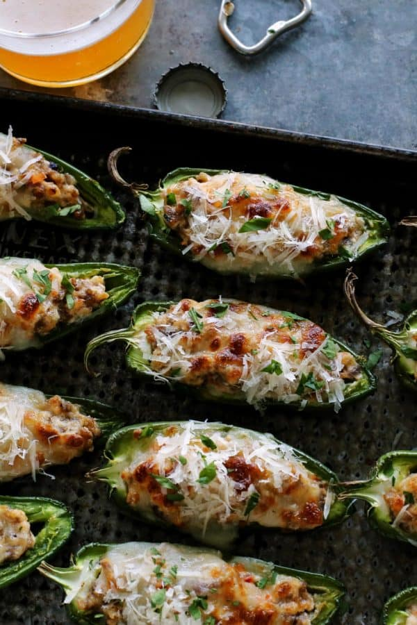 Jalapenos stuffed with Italian sausage and cheeses, baked on a pan.
