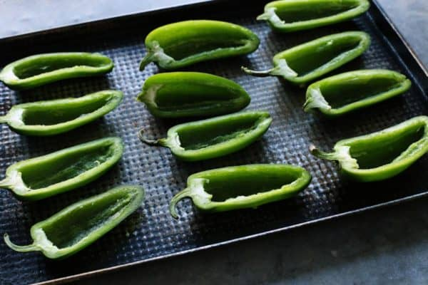 jalapeno pepper halves on a pan