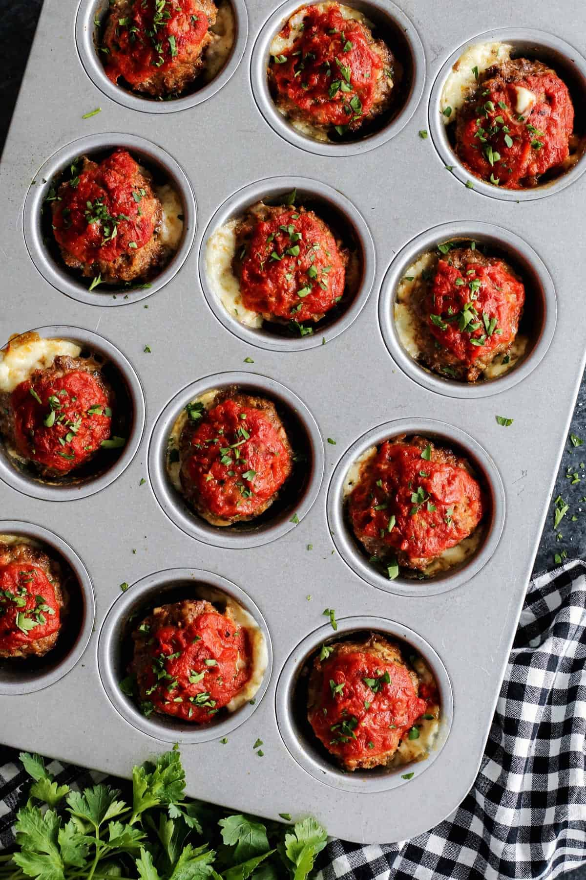 Meatloaf muffins with cheese in a muffin pan