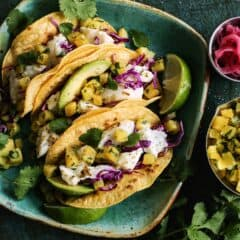 fish tacos with roasted pineapple on a plate